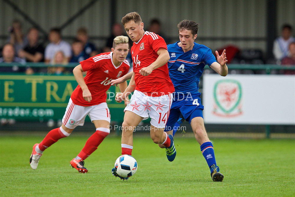 NEWPORT, WALES - Tuesday, September 6, 2016: Wales' Kieran Evans in action against Iceland's Viktor H Benediktsson during the International Friendly match at Dragon Park. (Pic by David Rawcliffe/Propaganda)