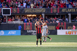 October 21, 2018 - Atlanta, GA, U.S. - ATLANTA, GA - OCTOBER 21: Atlanta United defender Julian Gressel (24) celebrates with the Atlanta United supports after the MLS game between the Atlanta United and the Chicago Fire on October 21, 2018 at the Mercedes-Benz Stadium in Atlanta, GA. (Atlanta United FC secured a place in next year's CONCACAF Champions League with a 2-1 victory against the visiting Chicago Fire. (Photo by John Adams/Icon Sportswire) (Credit Image: © John Adams/Icon SMI via ZUMA Press)