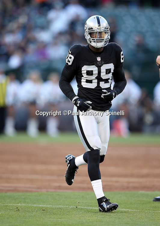 Oakland Raiders wide receiver James Jones (89) runs cross field during the 2014 NFL preseason football game against the Detroit Lions on Friday, Aug. 15, 2014 in Oakland, Calif. The Raiders won the game 27-26. ©Paul Anthony Spinelli