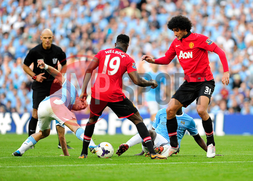 Manchester City's Pablo Zabaleta attempts to get the ball back - Photo mandatory by-line: Dougie Allward/JMP - Tel: Mobile: 07966 386802 22/09/2013 - SPORT - FOOTBALL - City of Manchester Stadium - Manchester - Manchester City V Manchester United - Barclays Premier League