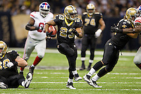 28 November 2011: Runningback (23) Pierre Thomas of the New Orleans Saints catches a pass and runs the ball for a first down against the New York Giants during the second half of the Saints 49-24 victory over the Giants at the Mercedes-Benz Superdome in New Orleans, LA.