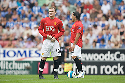 WIGAN, ENGLAND - Sunday, May 11, 2008: Manchester United's Wayne Rooney re-adjusts himself before the final Premiership match of the season against Wigan Athletic at the JJB Stadium. (Photo by David Rawcliffe/Propaganda)