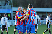 Crystal Palace players Glenn Murray and Dwight Gayle congratulate Scott Dann for his second goal during the The FA Cup Third Round match between Dover Athletic and Crystal Palace at Crabble Athletic Ground, Dover, United Kingdom on 4 January 2015. Photo by Phil Duncan.