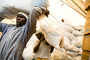 Workers carry UNICEF-sponsored domestic kits to be distributed to displaced populations across eastern DRC at a UNICEF depot in Goma, Eastern Democratic of Congo on Monday December 15, 2008. The kits contain blankets, a mosquito net, fabric, tarp, soap, cookware, floor mats and a jerican.