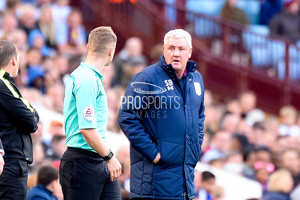 Aston Villa manager Steve Bruce  has a word with the linesman during the EFL Sky Bet Championship match between Aston Villa and Reading at Villa Park, Birmingham, England on 15 April 2017. Photo by Dennis Goodwin.