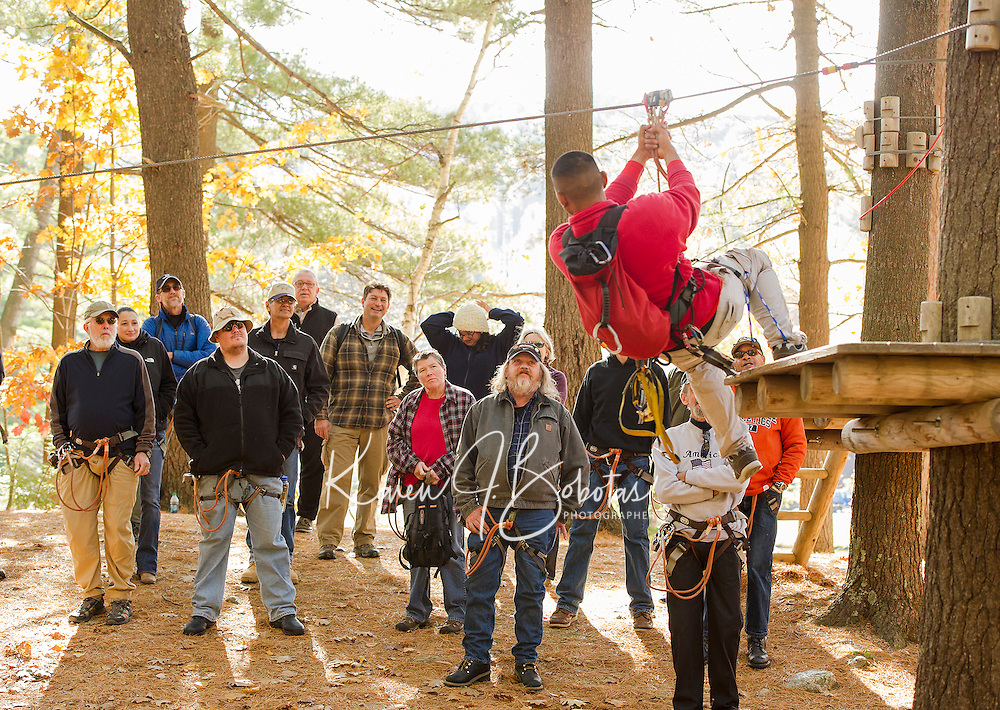 Guide Kevin Vorachith gives the Wounded Warrior group a quick intro of the ropes course before sending them through the Aerial Treetop Adventure at Gunstock on Monday afternoon.  (Karen Bobotas/for the Laconia Daily Sun)
