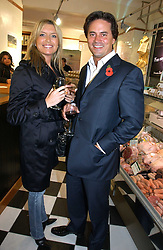 Actress TINA HOBLEY and OLIVER WHEELER at the opening of Jack O'Shea's butcher, Montpelier Street, London on 9th November 2006.  <br />
