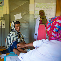 Seada Abdi assists out patient concerns in Jarso, Ethiopia.