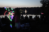 Middletown, New York - People wait for the fireworks display by the lake at Fancher-Davidge Park during a Stars and Stripes celebration on July 2, 2011.