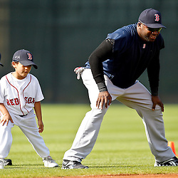 February 17, 2011; Fort Myers, FL, USA; Boston Red Sox first baseman David Ortiz (34) stretches along with his son D'Angelo Ortiz during spring training at the Player Development Complex.  Mandatory Credit: Derick E. Hingle