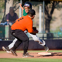 060313     B rian Leddy <br /> Orioles third baseman Isaac Gonzales tries to tag out Athletics runner Cael Stewart during Monday nights game at Ford Canyon Park.