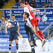 Craig Forsyth outjumps Gary Miller - Ross County v Dundee - IRN BRU Scottish Football League First Division at Victoria Park<br /> <br /> <br /> <br /> http://www.davidyoungphoto.co.uk
