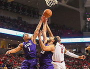 LUBBOCK, TX - MARCH 3: Desmond Bane #1 and Ahmed Hamdy-Mohamed #23 of the TCU Horned Frogs battle Tommy Hamilton IV #0 of the Texas Tech Red Raiders for the rebound during the game on March 3, 2018 at United Supermarket Arena in Lubbock, Texas. Texas Tech defeated TCU 79-75. Texas Tech defeated TCU 79-75. (Photo by John Weast/Getty Images) *** Local Caption *** Desmond Bane;Ahmed Hamdy-Mohamed;Tommy Hamilton IV
