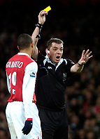 Photo: Ed Godden/Sportsbeat Images.<br /> Arsenal v Wigan Athletic. The Barclays Premiership. 11/02/2007. Referee Mr P Dowd, shows Arsenal keeper Jens Lehmann (out of picture), the yellow card.