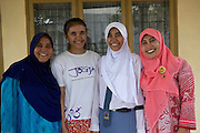 Iin Hartini (right) with two of her daughters and a friend outside her house.<br /> <br /> In 2007 Iin started her own business selling Nasi Goreng (fried rice). <br /> <br /> She makes it in bulk for the school canteen to sell to children who have their breakfast at school. <br /> <br /> Prior to signing up to Usaha Wanita Iin had been beginning to feel demotivated about her work and for a short time ceased making the rice. Since receiving the advice and mentoring she has become reenergised for her business and her profits have tripled.