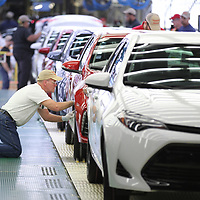 A Toyota Mississippi member makes final inspections to a Toyota Corolla before it leaves the line in Blue Springs.