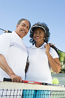 Couple with tennis equipment, portrait