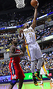 March 29, 2012; Indianapolis, IN, USA; Indiana Pacers power forward David West (21) shoots over Washington Wizards power forward Trevor Booker (35) at Bankers Life Fieldhouse. Indiana defeated Washington 93-89. Mandatory credit: Michael Hickey-US PRESSWIRE