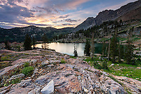 A warm Summer sunrise over Cecret Lake in Utah's Little Cottonwood Canyon, part of the Wasatch Mountains near Salt Lake City.