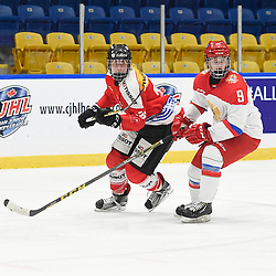 WHITBY, - Dec 15, 2015 -  WJAC Game 6- Team Russia vs Team Switzerland at the 2015 World Junior A Challenge at the Iroquois Park Recreation Complex, ON. Andre' Heim #26 of Team Switzerland and Aleksandr Iakovenko #9 of Team Russia follow the play during the second period.<br /> (Photo: Andy Corneau / OJHL Images)