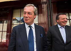 © Licensed to London News Pictures. 15/05/2015.  UKIP leader NIGEL FARAGE leaving Hertford Street Members Club in Mayfair, London with party donor Aaron Banks (right)  on May 15, 2015. Farage has been critiqued by members of the UKIP party after a u-turn on his decision to stand down as leader. Photo credit: Ben Cawthra/LNP