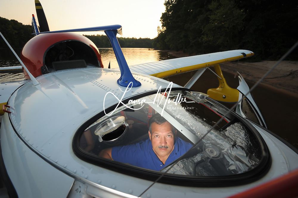 After a smooth seaplane landing on Lake Norman near the Highway 150 bridge Tello opens the front of the plane, steps out into the lake and pulls the plane up to the beach as if it were a boat. <br />
