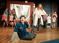 "Ryan Witham and Alexa Denbiac along with the Streetcar Kids Youth Theater perform ""Interjections"" from Schoolhouse Rock during dress rehearsal Wednesday evening.  (Karen Bobotas/for the Laconia Daily Sun)"
