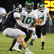 West Brunswick's Anthony Mcray blocks North Brunswick's Hunter Hendershot as Hunter Ashburn in the third game of the 28th Annual BB&T Football Jamboree Friday August 15, 2014 at Legion Stadium in Wilmington, N.C. (Jason A. Frizzelle)