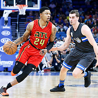 25 February 2017: Atlanta Hawks forward Kent Bazemore (24) drives past Orlando Magic guard Mario Hezonja (8) during the Orlando Magic 105-86 victory over the Atlanta Hawks, at the Amway Center, Orlando, Florida, USA.