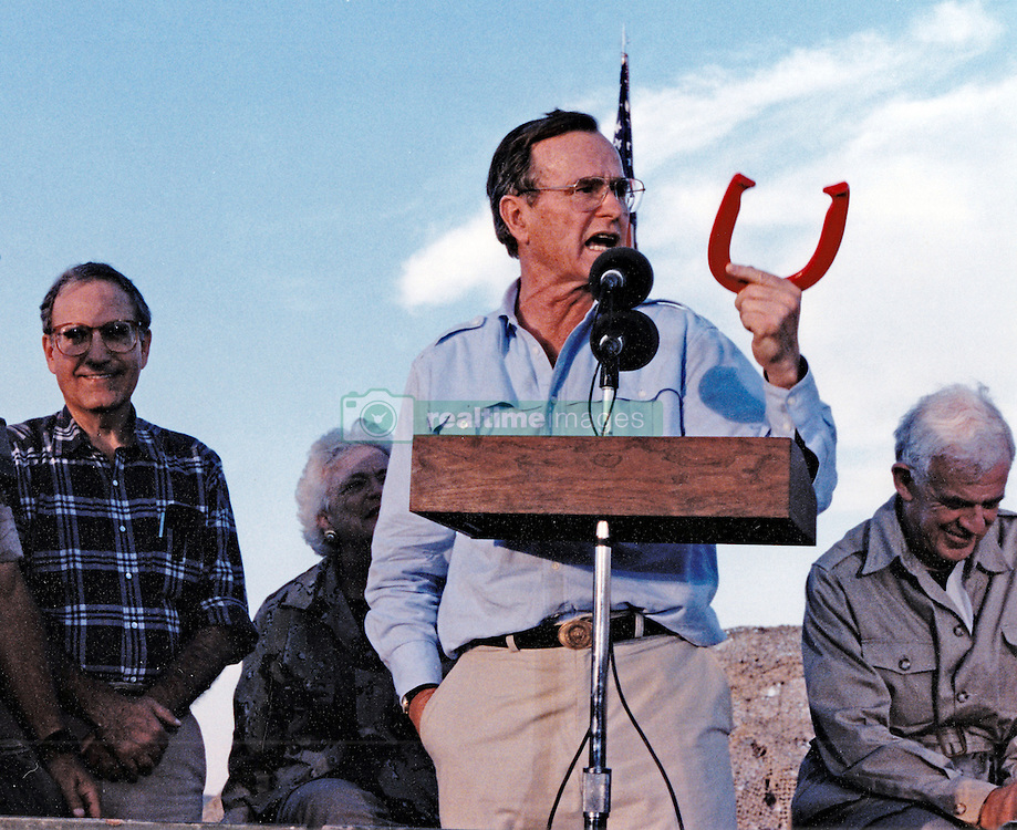 United States President George H.W. Bush speaks to US military personnel in Saudi Arabia, during Operation Desert Shield, on November 22, 1990. From left to right: United States Senate Majority Leader George Mitchell (Democrat of Maine); first lady Barbara Bush (partially obscured); President Bush; and Speaker of the United States House Tom Foley (Democrat of Washington) Photo by Ed Bailey / DoD via CNP/ABACAPRESS.COM