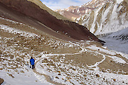 Leh - Friday, Dec 08 2006: Lorna Brooks walks along a path in Hemis National Park. (Photo by Peter Horrell / http://www.peterhorrell.com)