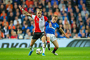 Rick Karsdorp (#27) of Feyenoord Rotterdam looks to hold off Scott Arfield (#37) of Rangers FC during the Europa League match between Rangers FC and Feyenoord Rotterdam at Ibrox Stadium, Glasgow, Scotland on 19 September 2019.