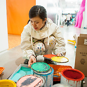 "March 10, 2012 - New York, NY : Misaki Kawai selects her colors as she continues the installation of her new exhibit ""Love from Mt. Pom Pom,"" at the Children's Museum of the Arts in the south village on Saturday March 10. CREDIT: Karsten Moran for The New York Times"