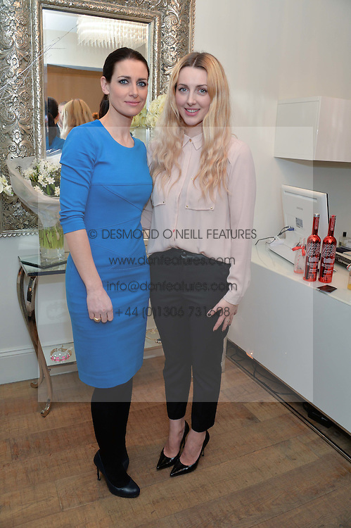 Left to right, sisters KIRSTY GALLACHER and LAURA GALLACHER at a Valentine's charity event to raise heart awareness and support the charity Arrhythmia Alliance held at Sophie Gass, 4 Ladbroke Grove, London on 13th February 2014.
