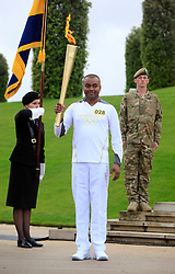 © Licensed to London News Pictures. 30/06/2012, National Memorial Arboretum, Staffordshire.   Corporal Johnson Beharry VC brings the Olympic Torch to the National Memorial Arboretum today as members of the Armed Forces and the general public celebrate Armed Forces Day.  Photo credit : Alison Baskerville/LNP