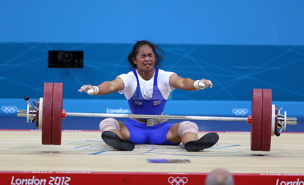 Rattikan Gulnoi of Thailand falis to lift 136 kg during the women's 58kg weightlifting event during day 3 of the London Olympic Games London, 30 Jul 2012..(Jed Jacobsohn/for The New York Times)....