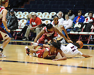 """Arkansas' Ashley Daniels (12), Arkansas' Dominique Robinson (21), and Ole Miss' Kenyotta Jenkins (11) and Valencia McFarland (3) go for the ball at the C.M. """"Tad"""" Smith Coliseum in Oxford, Miss. on Thursday, January 12, 2012."""