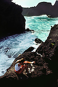 Waves breaking on the rocky seashore at Hana, Maui, Hawaii. USA