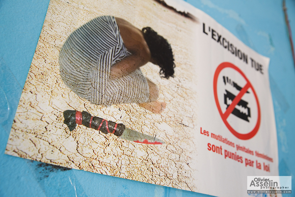 Poster stipulation that FGM/C kills and is punished by law in the offices of UNICEF partner NGO OIS Afrique in Katiola, Cote d'Ivoire on Friday July 12, 2013.