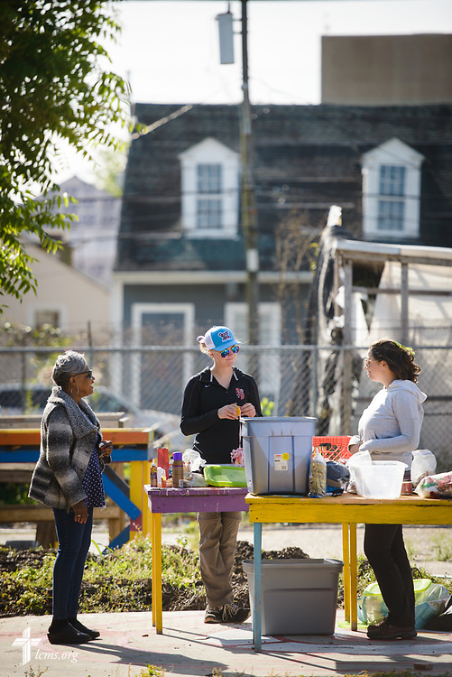 Gloria Ward talks with Young Adult Corps participants Courtney Haag (center) and Madison Ezzell on Thursday, April 5, 2018, at Ward's community garden in New Orleans. LCMS Communications/Erik M. Lunsford