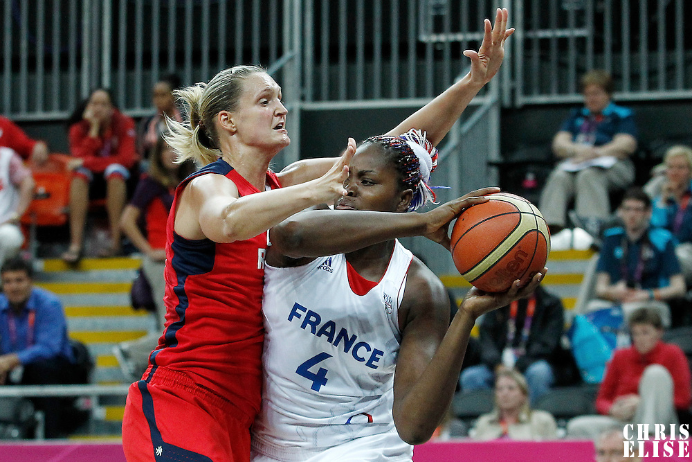 07 August 2012: France Isabelle Yacoubou looks to pass the ball over Czech Republic Petra Kulichova during 71-68 Team France victory over Team Czech Republic, during the women's basketball quarter-finals, at the Basketball Arena, in London, Great Britain.