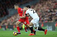 Football - 2016 / 2017 Premier League - Liverpool vs. Watford<br /> <br /> Philippe Coutinho of Liverpool holds off Daryl Janmaat of Watford during the match at Anfield<br /> <br /> COLORSPORT/LYNNE CAMERON