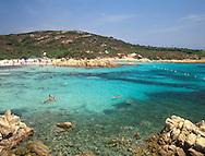 The sea, rocks and swimmers at Romazzino Beach<br /> Costa Smerlada  Sardinia  Italy