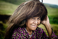 Philippines, Batanes. Ivatan woman, wearing a typical headdress protecting her head against the sun and wind.
