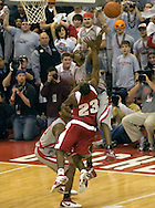MORNING JOURNAL/DAVID RICHARD.Ohio State's Ron Lewis, back, blocks Wisconsin's Kammron Taylor's shot as time expires during the second half Sunday, Feb. 25, 2007, in Columbus, Ohio. Ohio State beat Wisconsin 49-48.