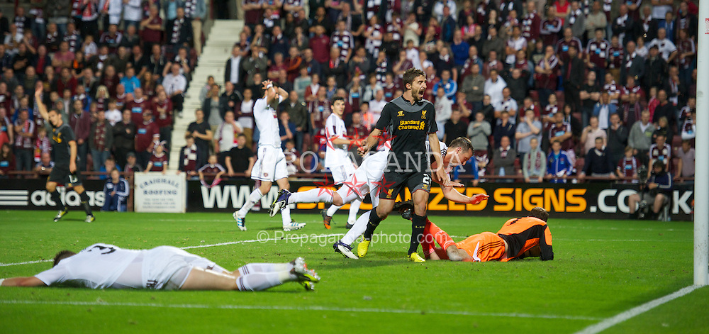 EDINBURGH, SCOTLAND - Thursday, August 23, 2012: Liverpool's Fabio Borini celebrates as Heart of Midlothian's Andrew Webster scores an own-goal during the UEFA Europa League Play-Off Round 1st Leg match at Tynecastle. It was the only goal of the game and handed the Reds a 1-0 away victory. (Pic by David Rawcliffe/Propaganda)
