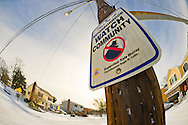 Merrick, New York, U.S. January 3, 2014. Neighborhood Watch Community sign looms on light pole along snow empty street as a dangerous deep freeze settles in, after a blizzard dumped 6-12 inches of snow on Long Island. The temperature range is 13 to 18 degrees Fahrenheit (-11° to -8° Celsius), with wind gusting up to 45 mph. Wind chill factors make it between 5° F to -10° F (-15° to -23° C), with record lows expected at night.