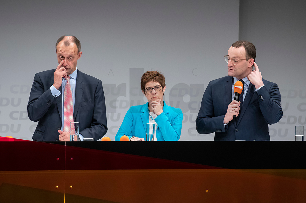 30 NOV 2018, BERLIN/GERMANY:<br /> Friedrich Merz (L), CDU, Rechtanwalt und ehem. stellv. CDU/CSU Fraktionsvorsitzender, Annegret Kramp-Karrenbauer (M), CDU Generalsekretaerin, und Jens Spahn (R), CDU, Bundesgesundheitsminister, waehrend der Fragerunden der Teilnehmer,  Regionalkonferenz der CDU zur Vorstellung der Kandidaten fuer das Amt des Bundesvorsitzenden der CDU, Estrell Convention Center<br /> IMAGE: 20181130-01-065