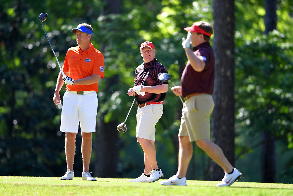 David Dukes reacts to a shot by Kirby Smart during the Chick-fil-A Peach Bowl Challenge at the Oconee Golf Course at Reynolds Plantation, Sunday, May 1, 2018, in Greensboro, Georgia. (Dale Zanine via Abell Images for Chick-fil-A Peach Bowl Challenge)