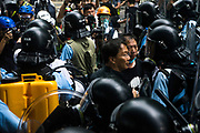 A protester tries to confront and talk to the riot police in front of the Central Government Offices, during a protest against a proposed extradition law in Hong Kong, SAR China, on Wednesday, June 12, 2019. Hong Kong's legislative chief postponed the debate on legislation that would allow extraditions to China after thousands of protesters converged outside the chamber demanding the government to withdraw the bill. Photo by Suzanne Lee/PANOS